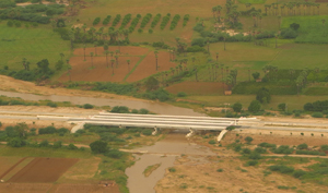 New Bridge on Yangon_Mandalay Road Myanmar 2014 Image David DuByne.pdf